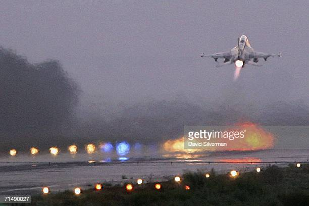An Israeli Air Force F16C jet takes off for a mission over Lebanon July 20 2006 at Ramat David Air Base in northern Israel The pilots of the 117th...