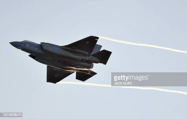 An Israeli Air Force F35 Lightning II fighter jet performs during a graduation ceremony of Israeli air force pilots at the Hatzerim Air Force base in...