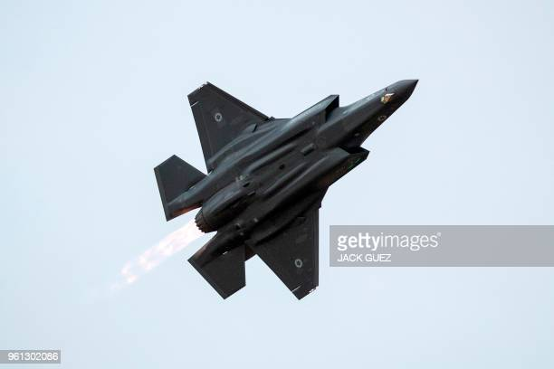 An Israeli Air Force F35 Lightning II fighter jet performs during an air show at the graduation ceremony of Israeli air force pilots at the Hatzerim...