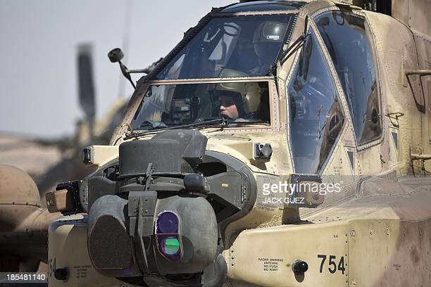An Israeli air force pilot and his gunner are pictured in the cockpit of an Apache helicopter during a display for foreign media at the Ramon air...