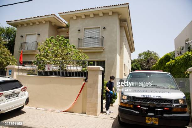 An Israeli Ambulance enters the house parking of China's Ambassador to Israel Du Wei, after he was found dead in his home on May 17, 2020 in...