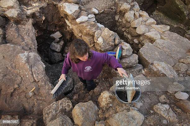 An Israeli antiquities authority worker clears debris as an excavation reveals for the first time a house from the Jewish village of Nazareth on...
