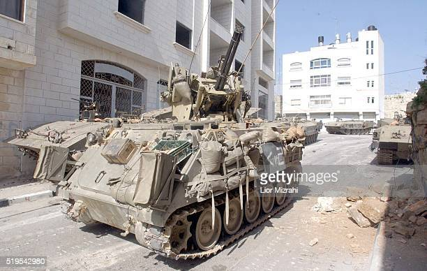 An Israeli APC's in the West Bank city of Ramallah Wednesday March 12 2002
