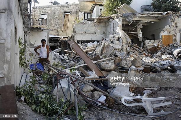 An Israeli Arab man stands in the ruins of a house, hit by a Katyusha missile the beginning of last week, August 14, 2006 in Haifa, Israel.Israel...