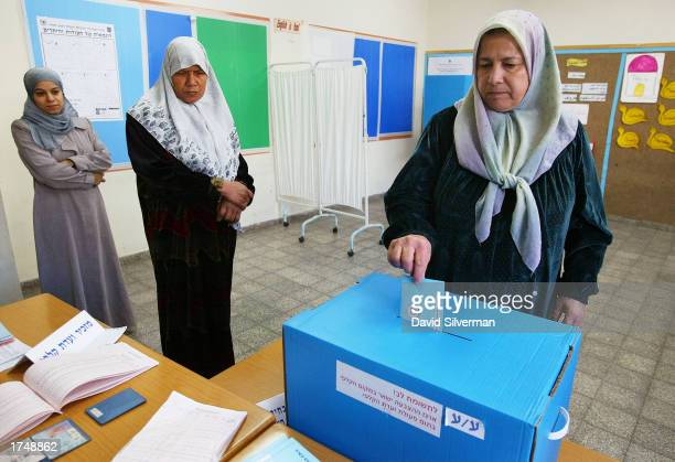 An Israeli Arab woman votes at a polling station in a school January 28 2003 in the village of Jaljuliya central Israel Israeli Prime Minister Ariel...