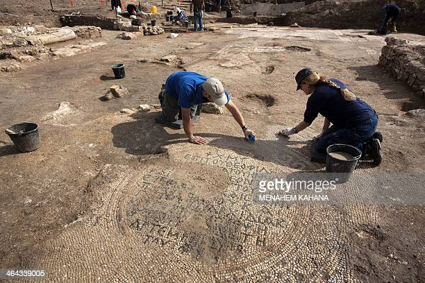 An Israeli archaeologist cleans a 1500yearold floor mosaic depicting the resurrection of Jesus Christ in a newlydiscovered church dating back to the...