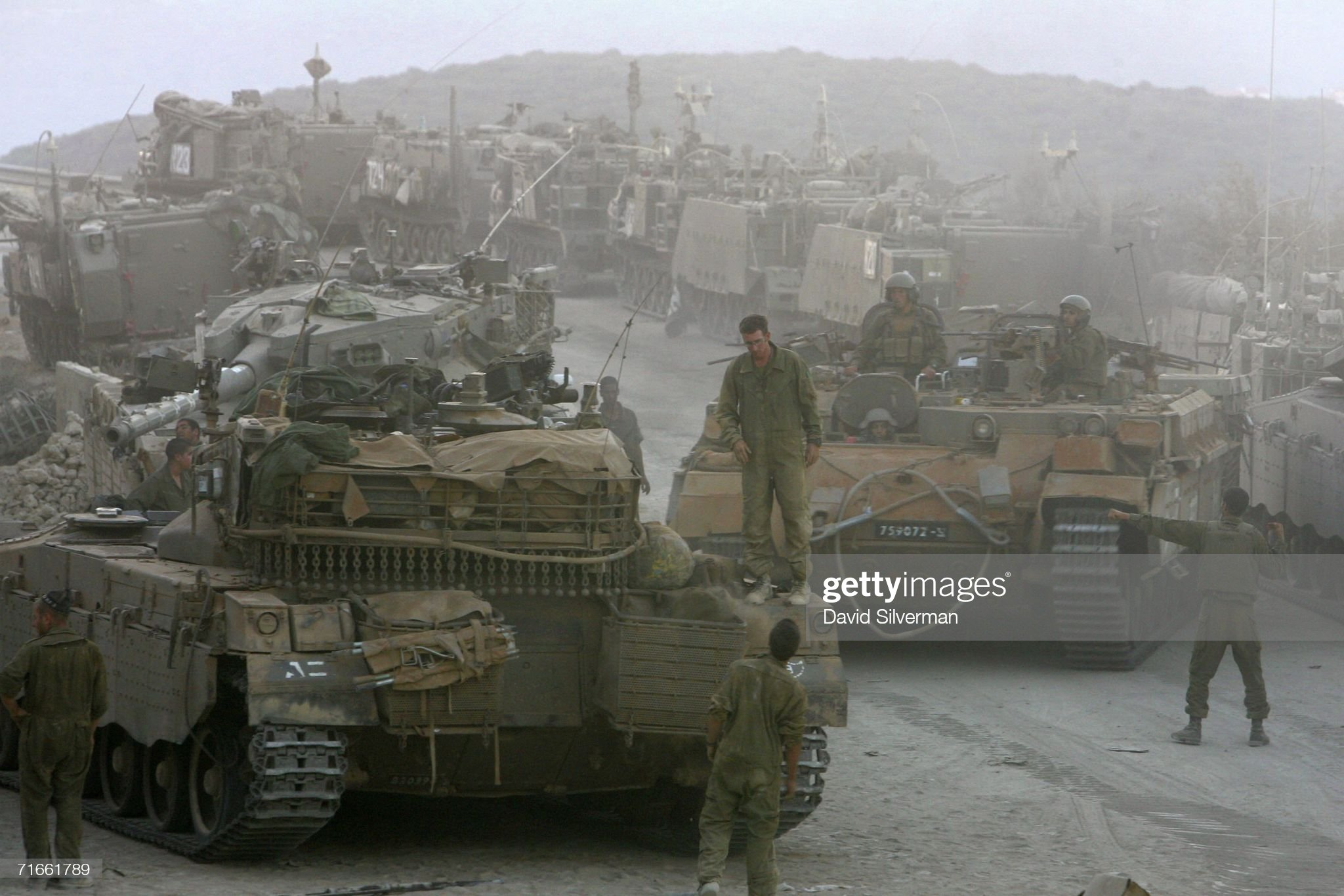 https://media.gettyimages.com/photos/an-israeli-armored-personnel-carrier-makes-its-way-through-tanks-and-picture-id71661789?s=2048x2048