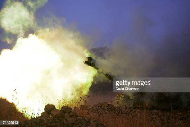 An Israeli army 155mm artillery cannon opens fire on Hezbollah targets in South Lebanon from a forward base July 16 2006 on the outskirts of the...