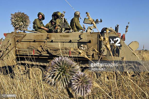 An Israeli army Armored Personnel Carrier maneuvers during a military exercise near the northern border with Syria on June 25 2013 in the...