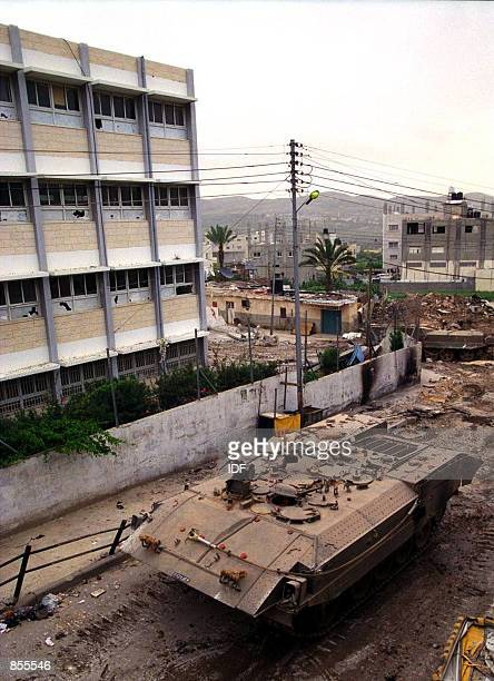 An Israeli army armored personnel carrier patrols the Akhbar refugee camp April 17 2002 in the West Bank town of Nablus US Secretary of State Colin...