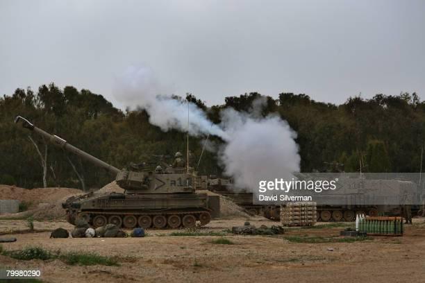 An Israeli army artillery battery fires a ranging shot in the Gaza Strip from a forward base February 25 2008 near Kibbutz Nahal Oz on Israel's...