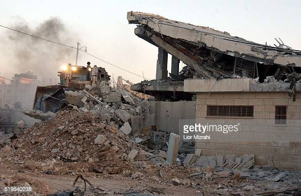 An Israeli army bulldozer destroyed building next to Yasser Arafat's compound in Ramallah September 22 2002 The Israeli army pressed ahead with...