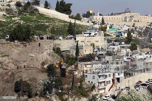 An Israeli army bulldozer destroys Palestinian houses in the east Jerusalem Arab neighbourhood of Silwan in Jerusalem's old city on January 28 2013...