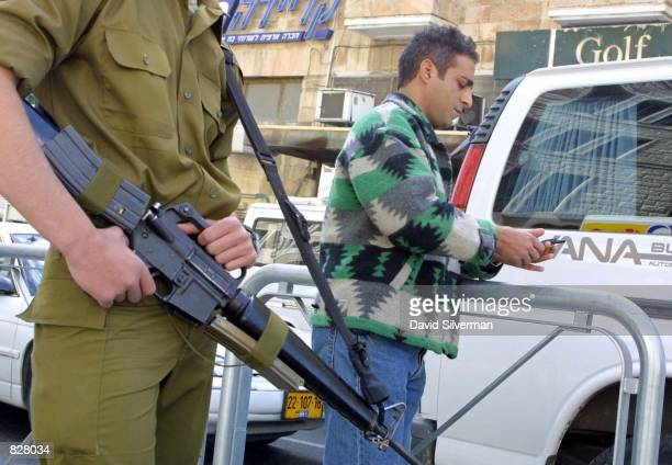 An Israeli army conscript patrols a downtown Jerusalem street March 7 as thousands of police and security personnel are on guard against threatened...