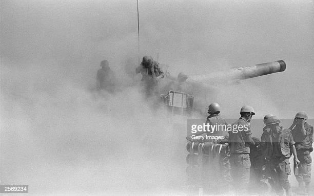 An Israeli army longrange 203mm canon firing at Syrian targets October 11 1973 on the Golan Heights during the Yom Kippur War Israeli Prime Minister...