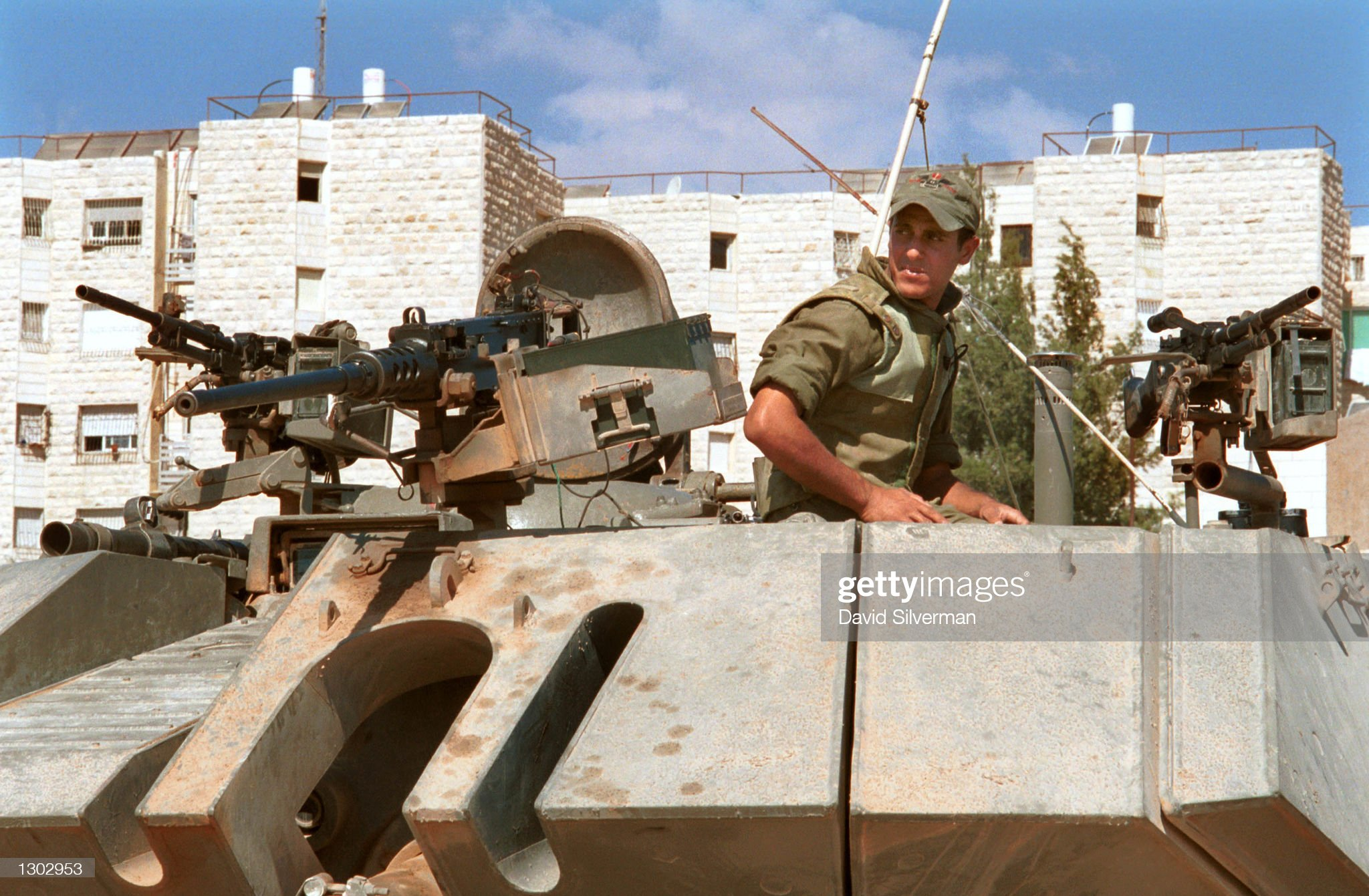 https://media.gettyimages.com/photos/an-israeli-army-m60-tank-maintains-a-hilltop-position-next-to-the-picture-id1302953?s=2048x2048