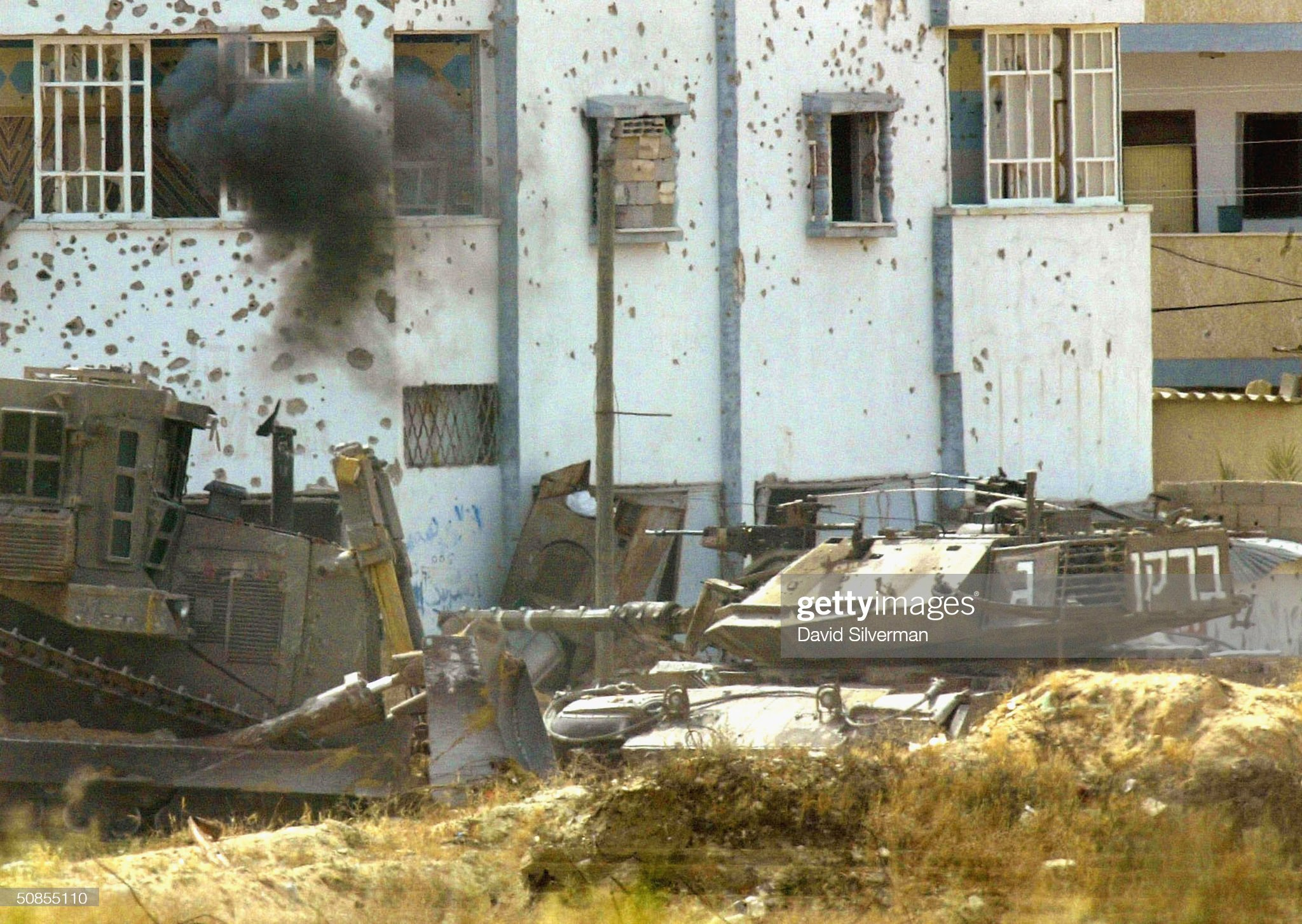 https://media.gettyimages.com/photos/an-israeli-army-merkava-tank-and-an-armored-bulldozer-operate-on-may-picture-id50855110?s=2048x2048