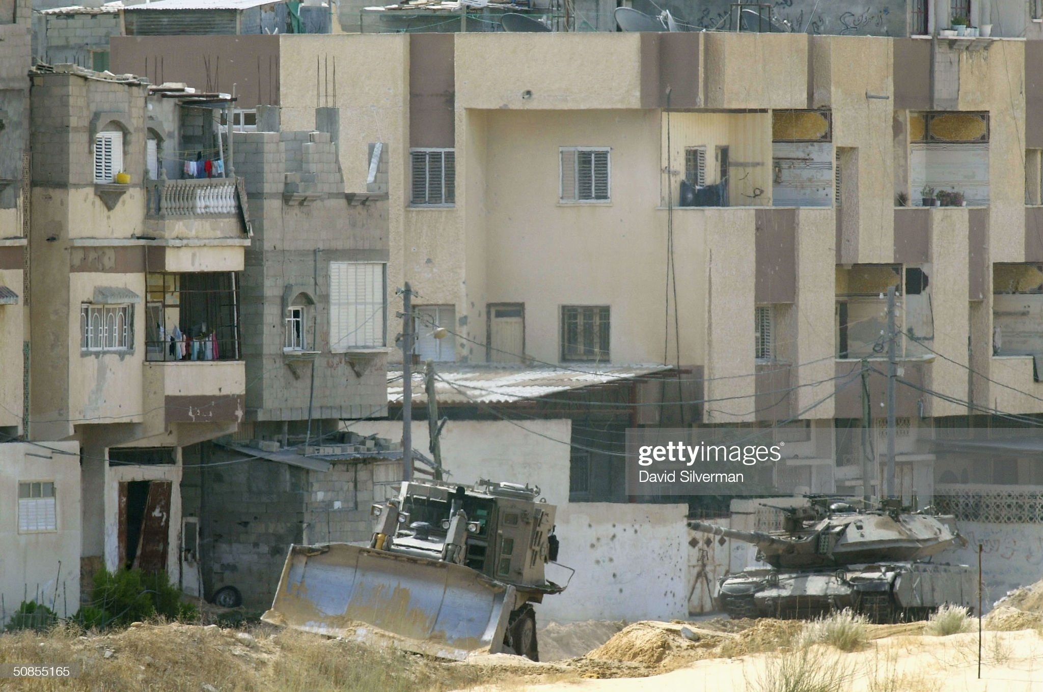 https://media.gettyimages.com/photos/an-israeli-army-merkava-tank-and-an-armored-bulldozer-operate-on-may-picture-id50855165?s=2048x2048