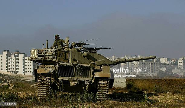 An Israeli army Merkava tank is deployed August 21 2003 hours after his unit deployed on the outskirts of the West Bank Palestinian town of Ramallah...