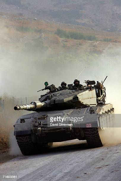 An Israeli army Merkeva tank returns to Israel after a night of action against Hezbollah militia in southern Lebanon August 8 2006 on Israel's...
