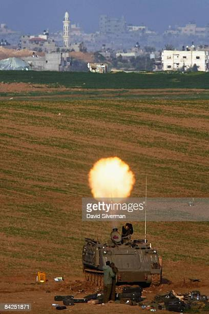 An Israeli army mortar team fires mortar shells into the Gaza Strip in support of troops fighting against Hamas militants January 12 2009 from a...