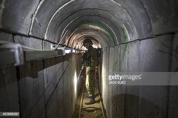 An Israeli army officer walks on July 25 2014 during an armyorganised tour in a tunnel said to be used by Palestinian militants from the Gaza Strip...