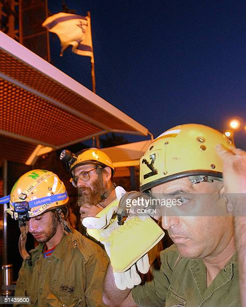 An Israeli army rescue team makes its way 08 October 2004 towards the Egyptian side of the border from the southern Israeli town of Eilat following a...