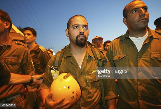 An Israeli army rescue team makes its way towards the Egyptian side of the border from the southern Israeli town of Eilat on October 8 2004 in Eilat...
