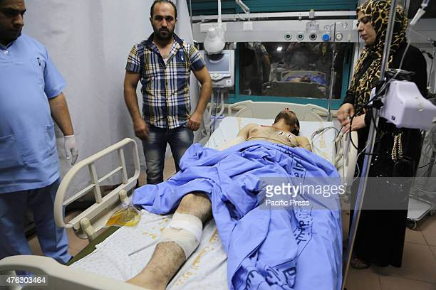 An Israeli army soldier receives treatment after having been shot by two Palestinian youths at a checkpoint at DCO points in Beit Jala Northwest City...