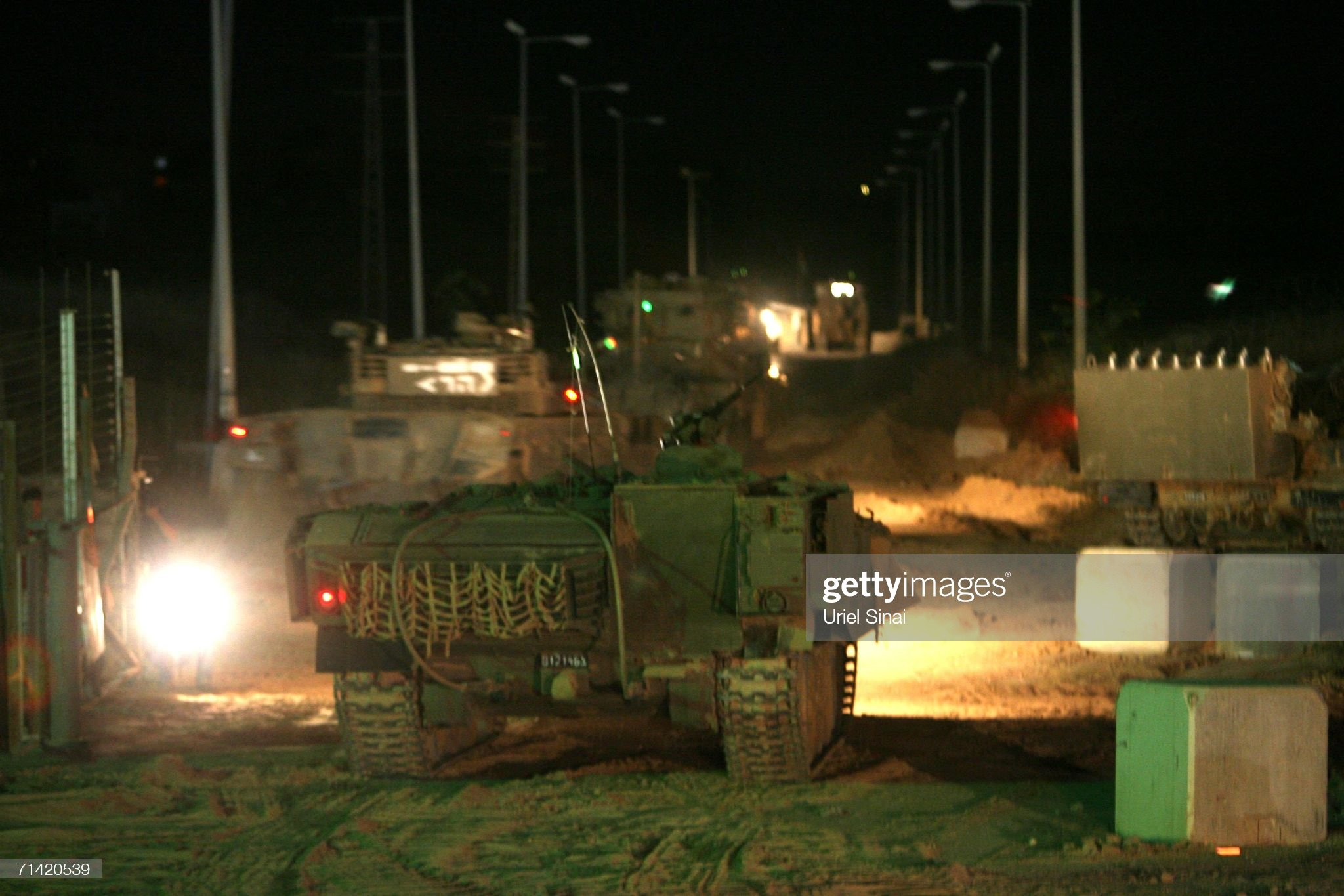 https://media.gettyimages.com/photos/an-israeli-army-tank-convoy-rolls-into-the-central-gaza-strip-july-12-picture-id71420539?s=2048x2048