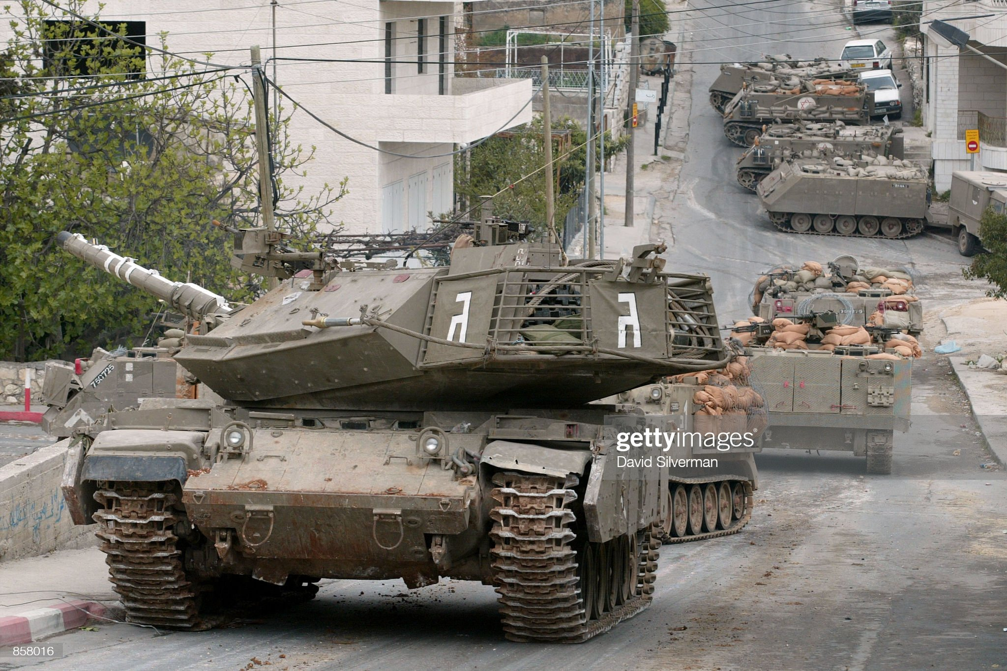 https://media.gettyimages.com/photos/an-israeli-army-tank-guards-the-head-of-an-armored-column-during-picture-id858016?s=2048x2048