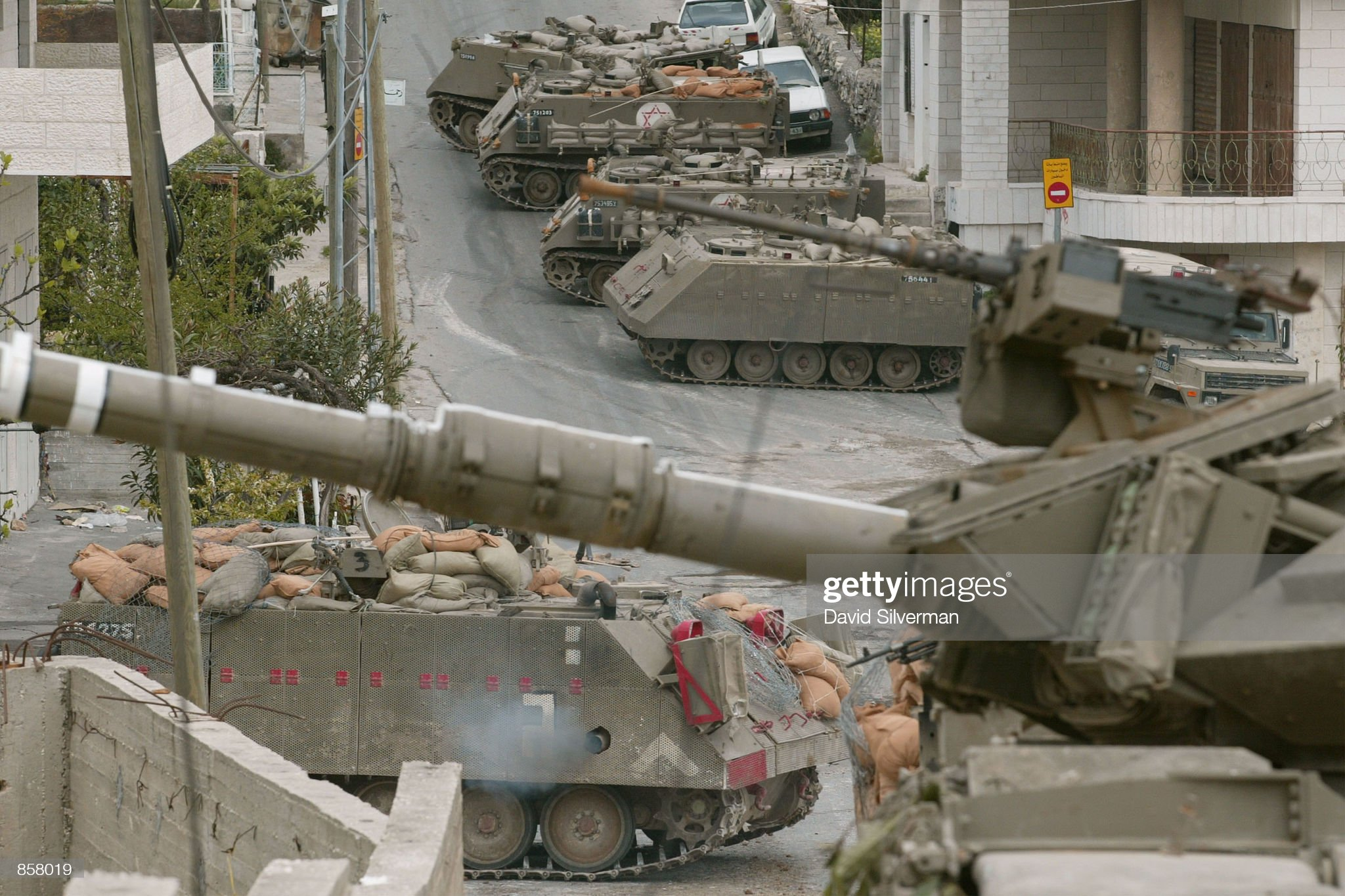 https://media.gettyimages.com/photos/an-israeli-army-tank-guards-the-head-of-an-armored-column-during-picture-id858019?s=2048x2048