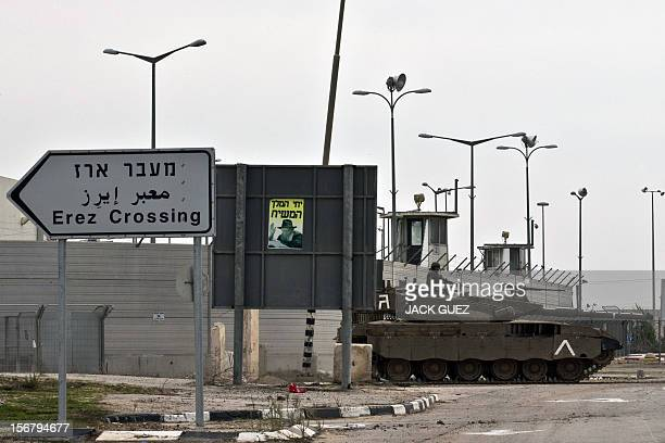 An Israeli army tank is seen along the Erez crossing passage along the southern Israeli border with the Palestinian Gaza Strip on November 21 2012 UN...