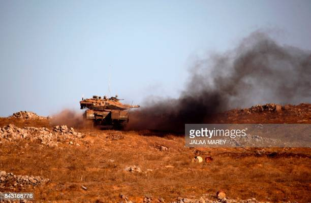 TOPSHOT An Israeli army tank manuevers during a military exercise simulating conflict with Lebanese movement Hezbollah in the Israeli annexed Golan...