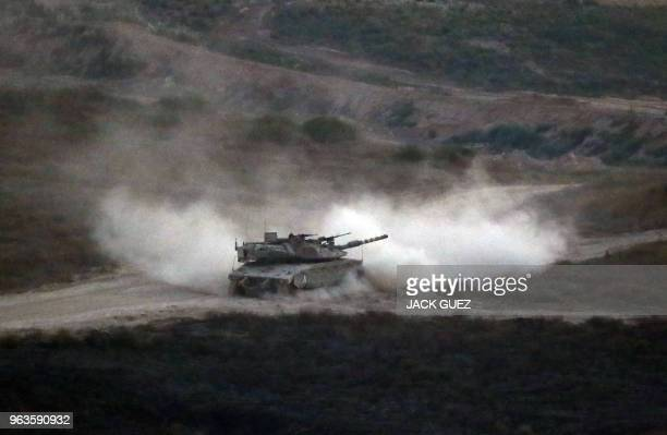 An Israeli army tank patrols along the border between Israel and the Gaza Strip on May 29 2018 Israel said it struck dozens of militant targets in...