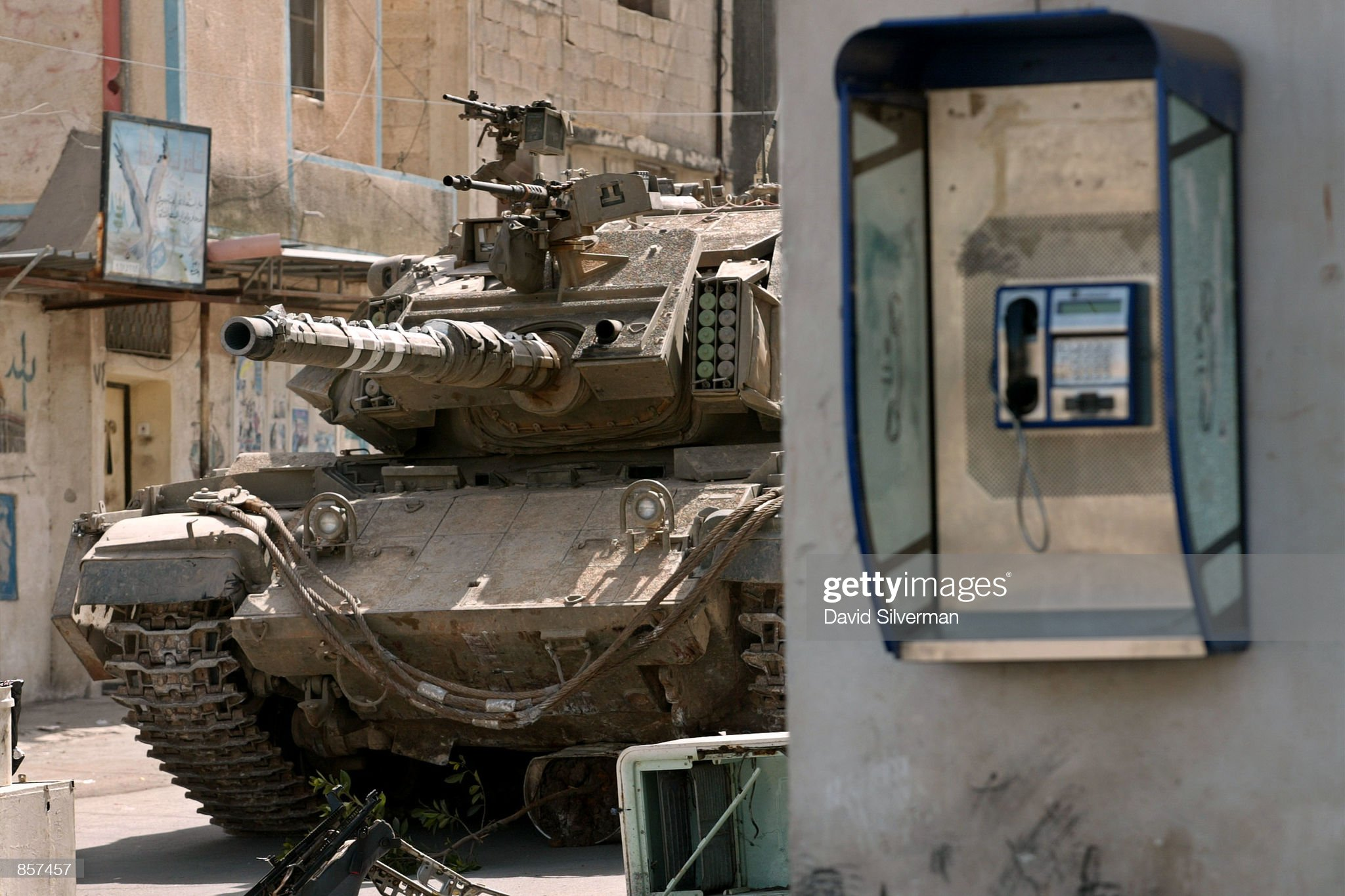 https://media.gettyimages.com/photos/an-israeli-army-tank-slowly-advances-march-7-2002-into-the-refugee-picture-id857457?s=2048x2048