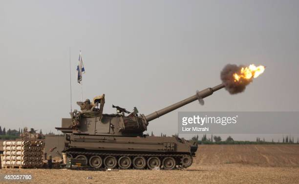 An Israeli artillery cannon fires a shell on July 12 2014 on Israel's border with the Gaza Strip Israel's operation 'Protective Edge' has entered its...