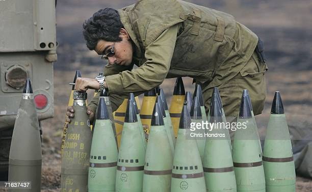 An Israeli artillery soldier prepares 155 mm shells for firing on August 13 2006 in the woods on the IsraeliLebanese border Shelling and fighting...