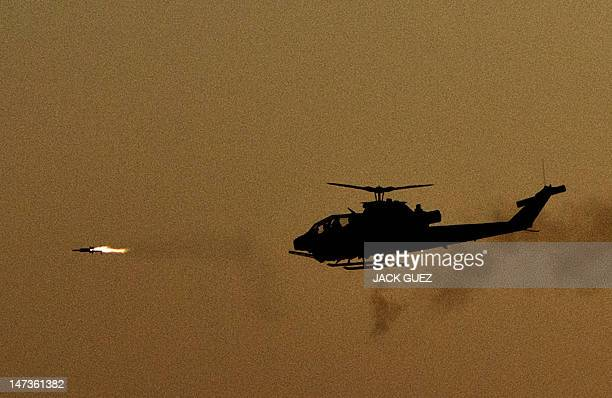 An Israeli Bell AH1 Cobra launches a missile at an air show during the graduation ceremony of Israeli pilots at the Hatzerim air force base in the...
