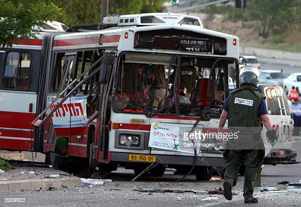 An Israeli bomb disposal expert checks for more bombs shortly after a Palestinian suicide bomber exploded himself on an early morning passenger bus...