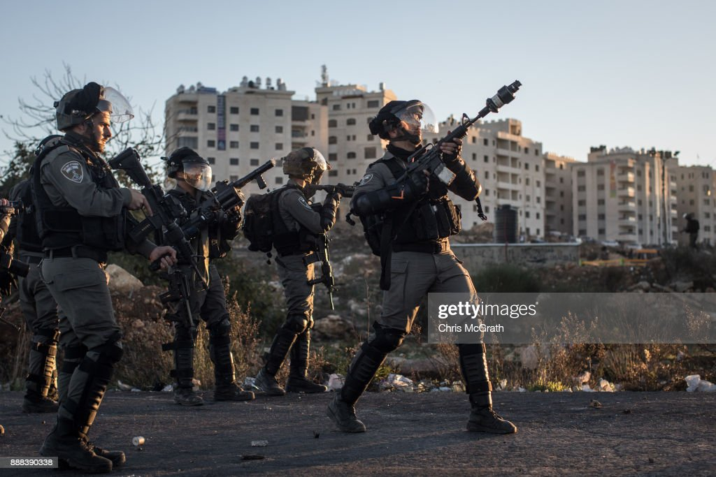 An Israeli border guard fires tear gas at Palestinian protesters during clashes near an Israeli checkpoint on December 8, 2017 in Ramallah, West Bank. At least 50 Palestinians have been wounded in clashes between Palestinian protestors and Israeli security forces in the West Bank and the Gaza Strip on Friday after thousands of protestors took to the streets in a second 'Day of Rage' following U.S. President Donald Trump's decision to recognize Jerusalem as Israel's capital on Wednesday.