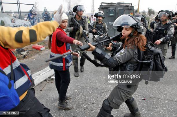 An Israeli border guard scuffles with Palestinian protesters during clashes north of Ramallah near the Israeli settlement of Beit El in the Israeli...
