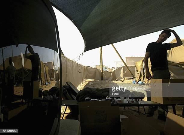 An Israeli border police officer looks into a tent in the Reim army base on August 19 2005 in the southern Gaza Strip As Israel's pullout from...