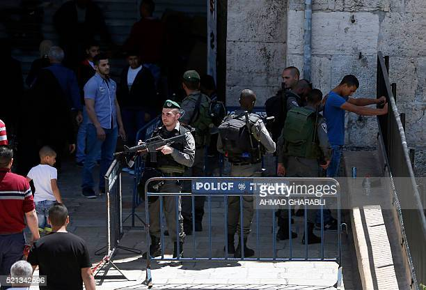 An Israeli border policeman frisks a Palestinian man at Damascus Gate a main entrance to Jerusalem's Old City before the Friday prayer at the alAqsa...