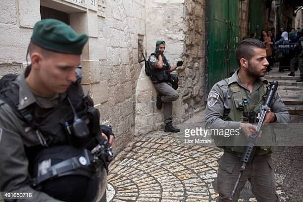 An Israeli border policemen stand guard next to a stabbing scene on October 7 2015 in Jerusalem's Old City Israel According to Israeli police a...