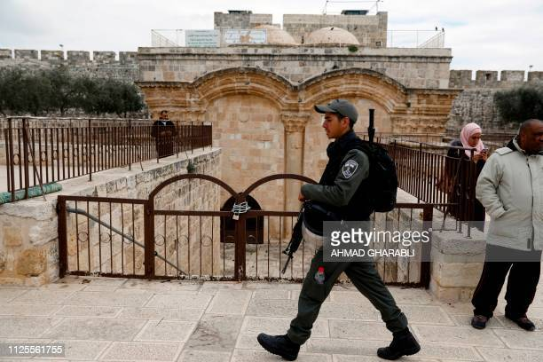An Israeli borderguard walks past a gate closed by the Police at the Al Aqsa mosque compound in Jerusalem's Old City on February 18 2019
