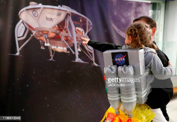 An Israeli boy plays with a model of the Israeli spacecraft Beresheet's at the Planetaya Planetarium in the Israeli city of Netanya on April 11 2019...