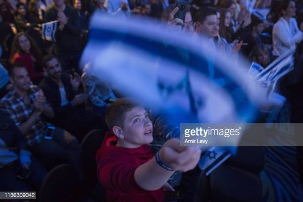 An Israeli boy waves the Israeli flag after Beresheet spacecraft fails to land safely on the moon on April 11 2019 in Tel Aviv Israel The Israeli...