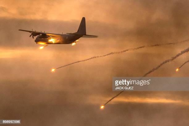 An Israeli C130 Hercules plane launches antimissile flares during an air show at the graduation ceremony of Israeli air force pilots at the Hatzerim...