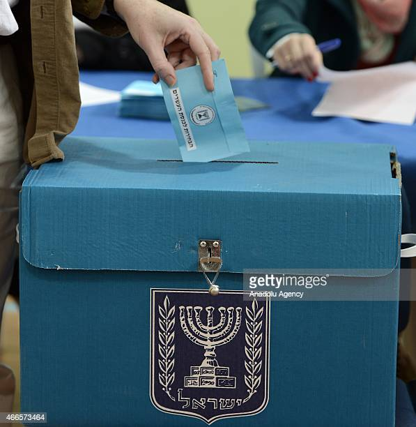 An Israeli citizen casts his vote at a polling station during legislative election in Jerusalem Israel on March 17 2015 Voting begin in Israels...